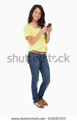 Beautiful Latin while using a smartphone against white background - stock photo