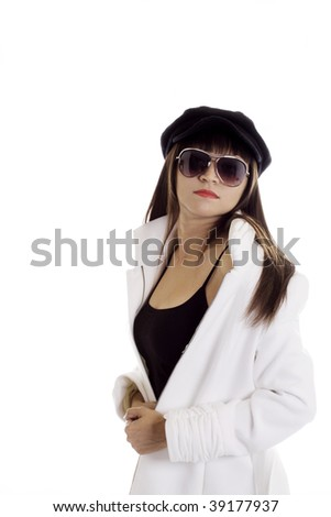 Beautiful latina model with a white coat, sunglasses and a french beret