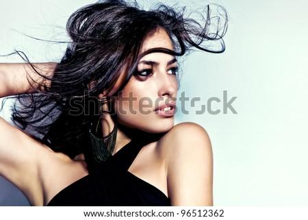 beautiful latino young woman portrait, studio shot - stock photo