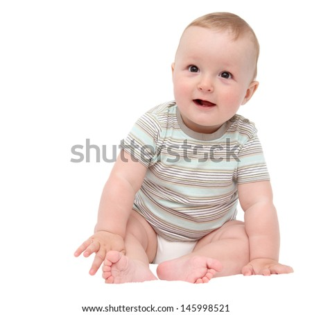 beautiful laughing happy baby boy sitting on white bed