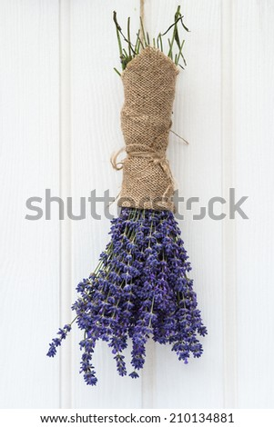 Beautiful lavender bunch in rustic home styled setting with copy space - stock photo