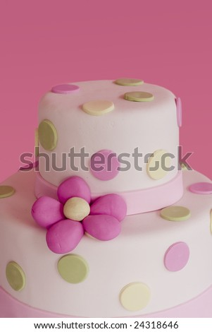 Beautiful layered sugar cake with pink flowers. - stock photo