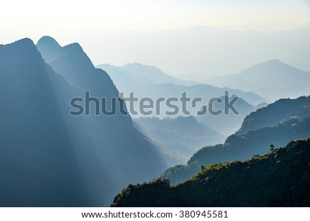 Beautiful layers of mountain range landscape and forest from top view in majestic sunlight and fog at Doi Luang Chiang Dao National Park, Chiangmai, Thailand - stock photo