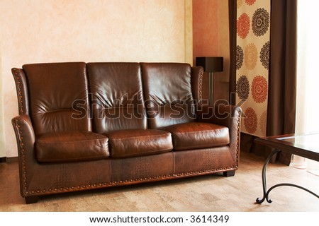 Beautiful leather sofa and table at a window