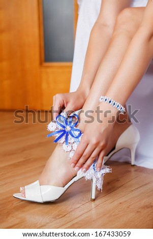 Beautiful leg of the young bride  - stock photo