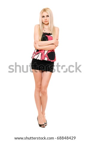 Beautiful leggy young blonde in black miniskirt. Isolated - stock photo
