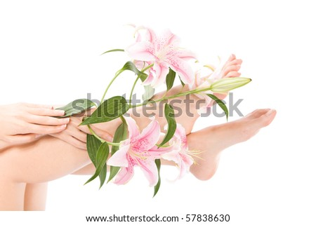 Beautiful legs and flower on isolated white - stock photo