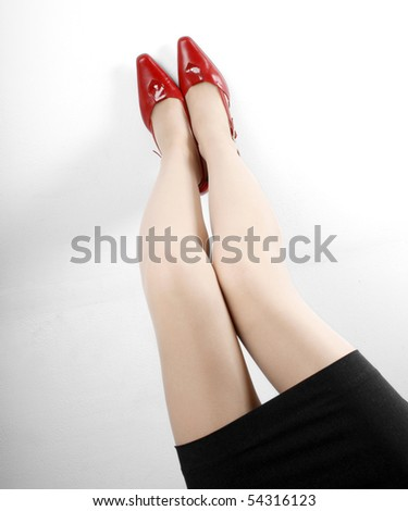 Beautiful legs and red high heels shoes - stock photo