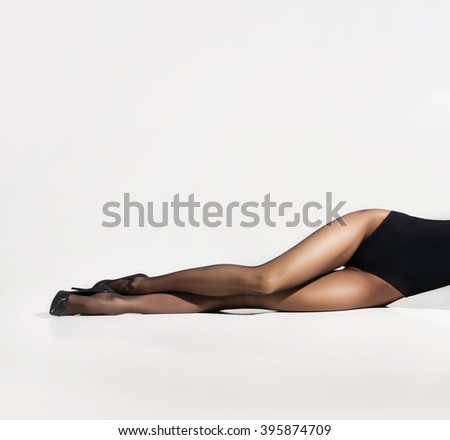 Beautiful legs in pantyhose over white background - stock photo