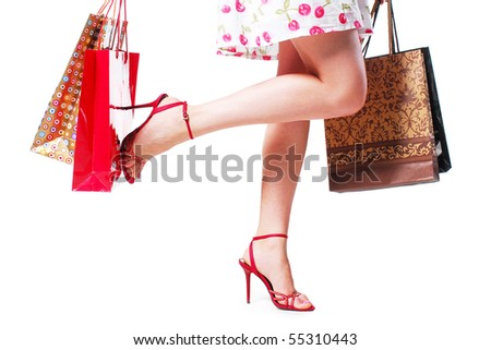 Beautiful legs in shoes isolated on white background - stock photo