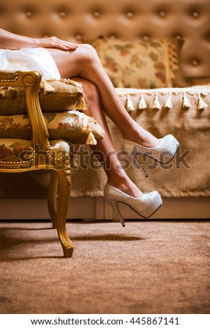 Beautiful legs of the bride - stock photo