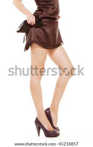Beautiful legs of young woman on isolated white background - stock photo