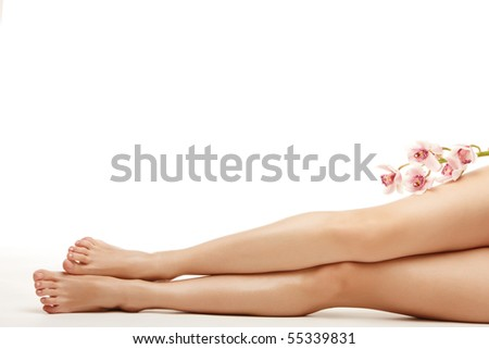 Beautiful legs of young woman over isolated white background - stock photo
