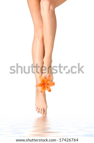 Beautiful legs with a lily flower - stock photo