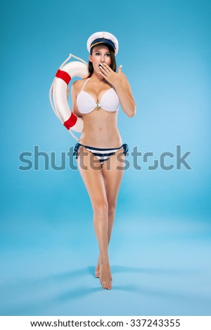 Beautiful lifeguard isolated on blue background - stock photo