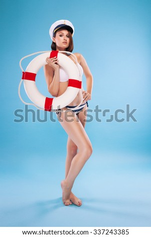 Beautiful lifeguard isolated on blue background