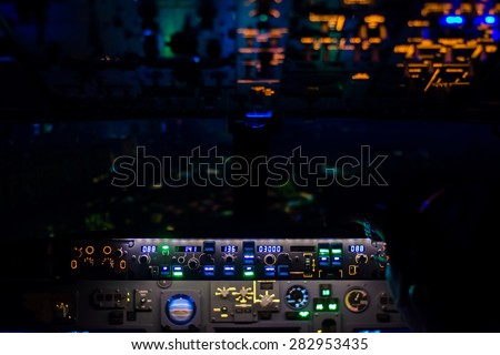 beautiful light from airplane console in pilot cockpit - night view - stock photo