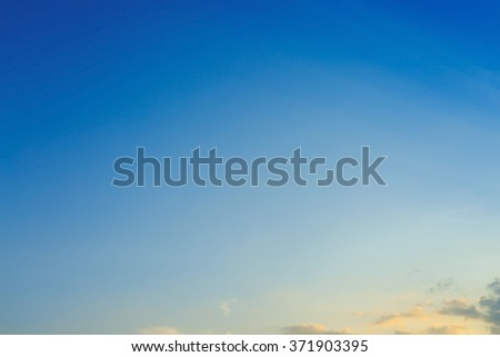 beautiful light on clear blue sky, light beam of sunlight through clouds above sunset sky - stock photo