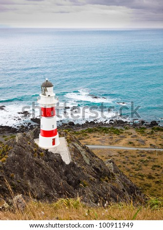 Beautiful lighthouse at Cape Palliser, North Island, New Zealand - stock photo