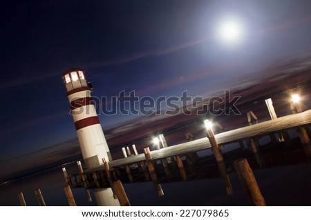 Beautiful lighthouse in the night  - stock photo