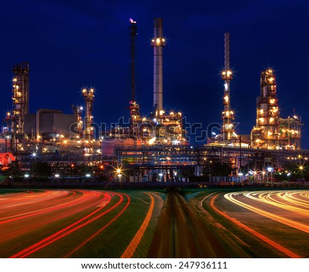 beautiful lighting of oil refinery plant in industry estate against blue sky of night - stock photo
