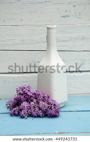 Beautiful Lilac branch in vase isolated on white background - stock photo