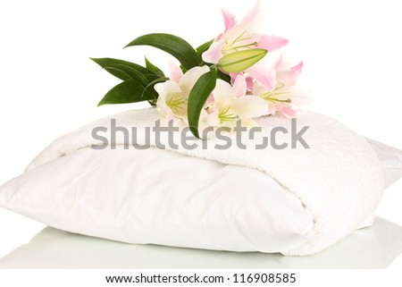 beautiful lily on pillow with towel isolated on white