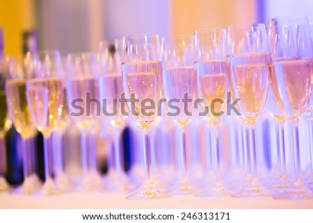 Beautiful line of different colored cocktails with smoke on a Christmas party, tequila, martini, vodka, and others on decorated catering bouquet table on open air party  - stock photo