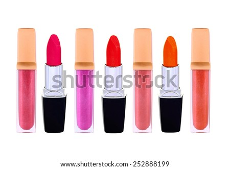 Beautiful lip glosses and lip sticks, isolated on white background - stock photo