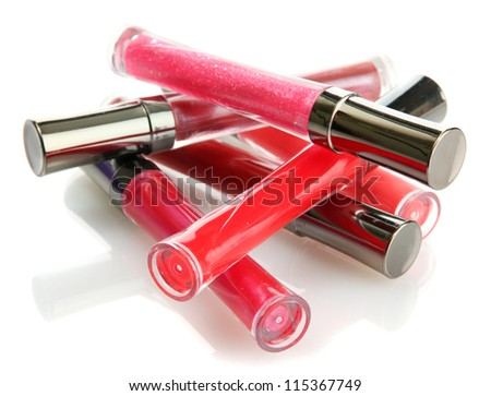 beautiful lip glosses, isolated on white - stock photo
