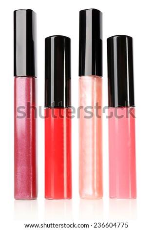 Beautiful lip glosses, isolated on white - stock photo