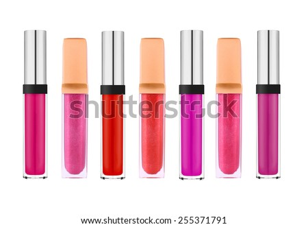 Beautiful lip glosses, isolated on white background - stock photo