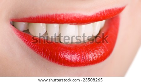 Beautiful lips and teeth of a young woman. Shallow DOF.