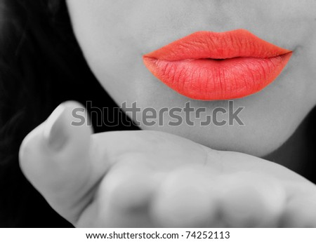 Beautiful lips sending a kiss with a highlighting color contrast lips - stock photo