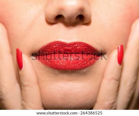 beautiful lips with red lipstick  - stock photo