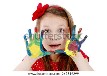 Beautiful little artist with dirty hands and smile on her face - stock photo