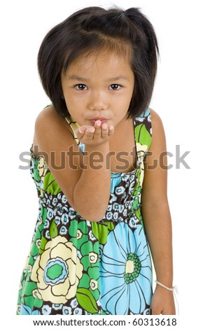 beautiful little asian girl blowing a kiss, isolated on white background - stock photo
