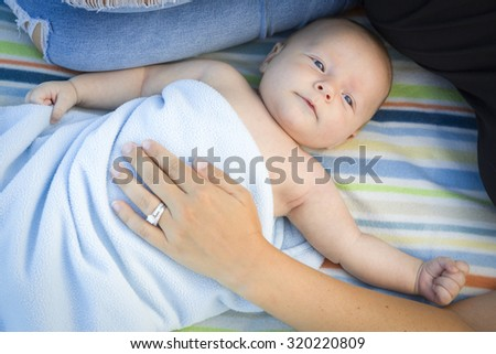 Beautiful Little Baby Boy Wrapped In His Blanket Resting With Mommy. - stock photo