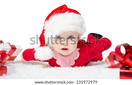 Beautiful little baby celebrates Christmas. New Year's holidays. Baby in a Christmas costume with gift. Isolated