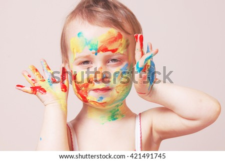beautiful  little baby girl doing make up (humorous picture) - stock photo