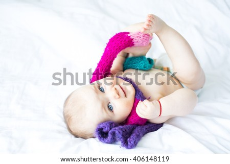 beautiful little baby girl with a woolen scarf - stock photo