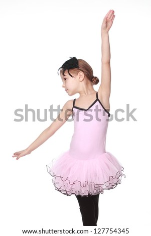 Beautiful little ballerina dancer wears a pink dress on a white background - stock photo