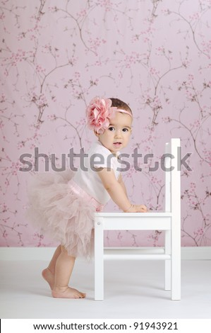 Beautiful little ballerina dressed in pink tutu - stock photo