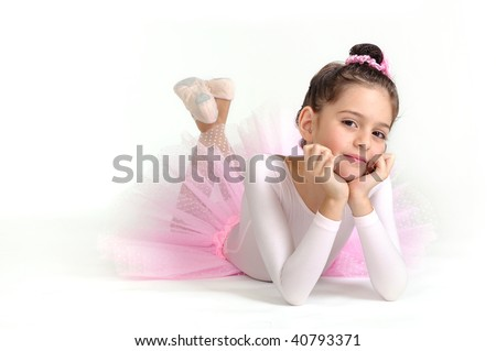 Beautiful little ballerina over a white blackground - stock photo