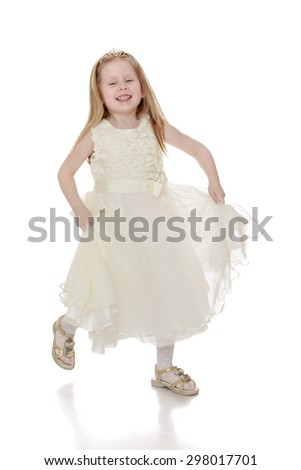Beautiful little blonde girl in a long airy dress Princess fun running around in the Studio-Isolated on white background - stock photo