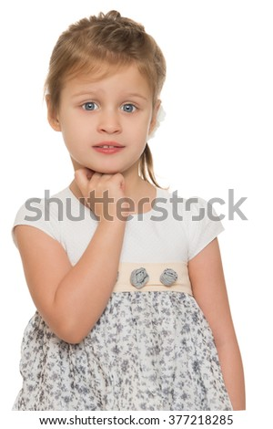 Beautiful little blonde girl in a smart dress. Closeup - Isolated on white background - stock photo