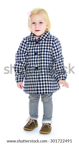 Beautiful little blonde girl in autumn coat in the box. The girl stares into the camera-Isolated on white background - stock photo