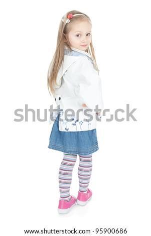 Beautiful little blonde girl in white raincoat posing in studio over white - stock photo