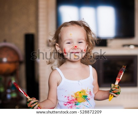 Beautiful little blonde hair girl, has happy fun smiling face, brown eyes, white t-shirt. Painted in skin hands. Child portrait. Creative concept. Water colors. Close up.