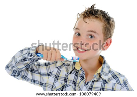 beautiful little boy cleans your teeth. Isolated on white background - stock photo